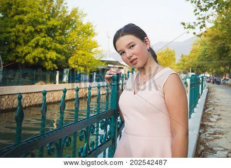 Thoughtful teenage girl outdoors portrait