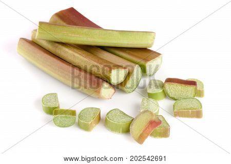 Chopped rhubarb stem isolated on white background cutout.
