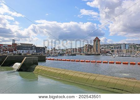 Barrage across Swansea harbour water in Wales