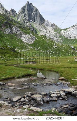River over lake Tremorgio on Canton Ticino in the Swiss alps