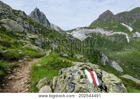 Pathway over lake Tremorgio on Canton Ticino in the Swiss alps