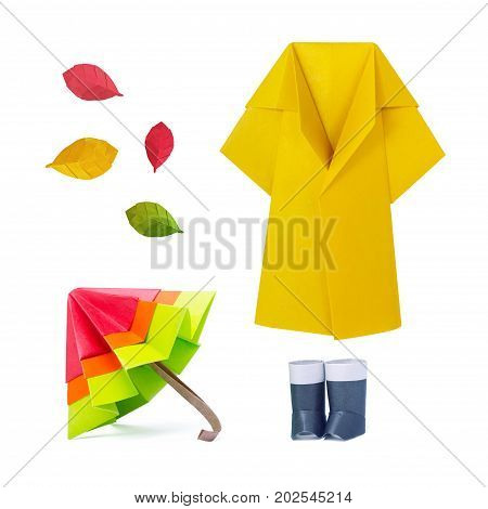Origami paper umbrella multicolor with gumboots and raincoat set on a white background