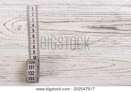 Tailoring Meter White measuring tape on wooden background