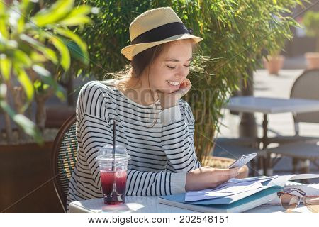 Closeup Photo Of Shy Beautiful Girl Looking At Display Of Her Cellphone While Exchanging Content And