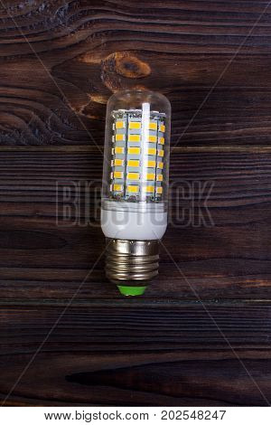 LED bulb on the wooden background Light Effect