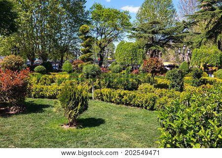 Tbilisi, Georgia - April 24, 2017: Green park near sulphur baths in old town of Tbilisi, Georgia and street light