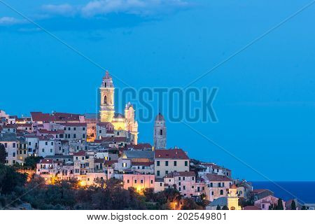 The Old Town Of Cervo, Liguria, Italy, With The Beautiful Baroque Church And Tower Bells Arising Fro