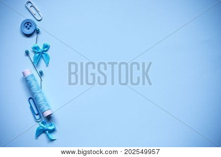 Sewing tool or craft tool on blue background top view or overhead shot with copy space