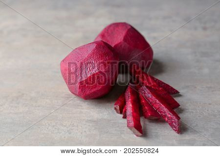 Delicious peeled and sliced ripe beets on table