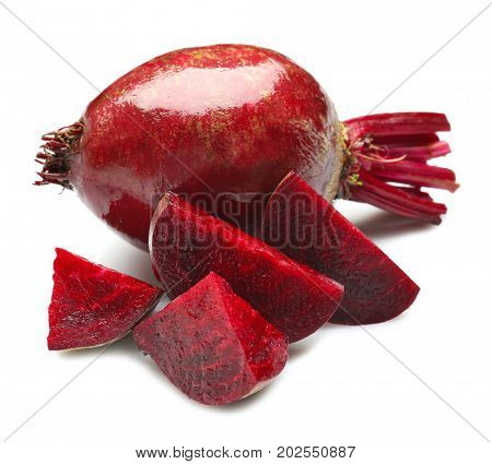 Delicious sliced ripe beets on white background