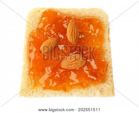 Slice of bread with apricot jam and almonds, isolated on white