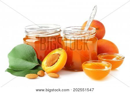 Apricot jam in jars and bowls, isolated on white