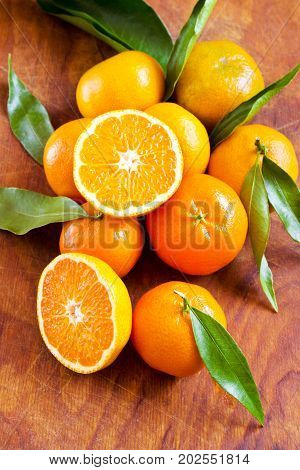 Fresh ripe mandarins with leaves on the table