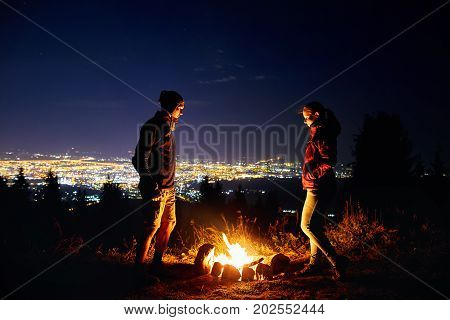 Romantic Couple Near Campfire At Starry Night