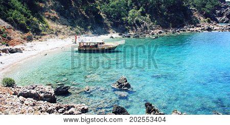 Tourist Boat In The Small Bay. Blue Sea In Turkey.