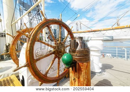 Beautiful wooden steering wheel on a big sailing ship