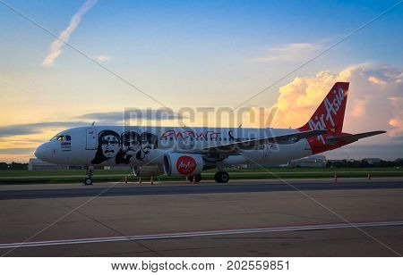 BANGKOKTHAILAND-AUGUST 11: Air Asia Airbus A320 preparing for take-off at sunrise in Don Muang international airport on Aug 11 2017. Air Asia company is the largest low cost airlines in Asia.