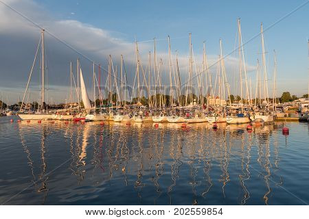 BORGHOLM, SWEDEN - JULY 22: Magical light a summer evening in Borgholm harbor at the swedish island Oland in the Baltic Sea. Photo on July 22, 2017 in  Borgholm, Sweden