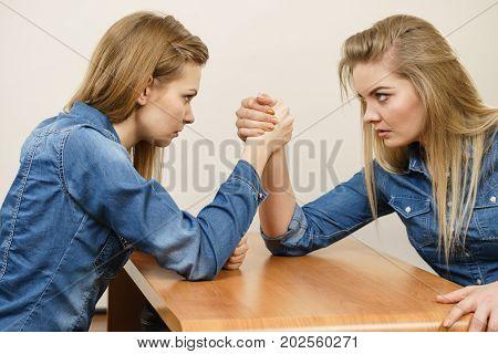 Two Women Having Arm Wrestling Fight