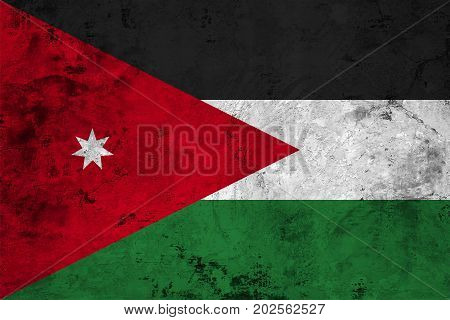 Flag of the Jordan against the background of the stone texture
