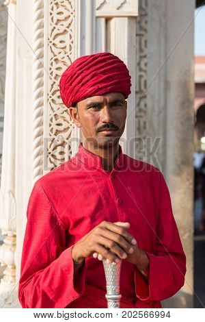 JAIPUR RAJASTHAN INDIA - MARCH 10 2016: Front picture of indian man inside of City Palace in Jaipur known as pink city of Rajasthan in India.