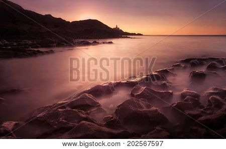 Sunrise at Bracelet Bay, featuring the Mumbles Lighthouse in Swansea, South Wales, UK