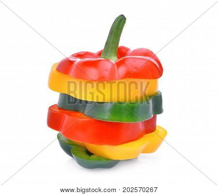 colorful slice of sweet bell pepper or capsicum isolated on white background