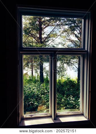 Photo of old rustic window from old Finnish loghouse.