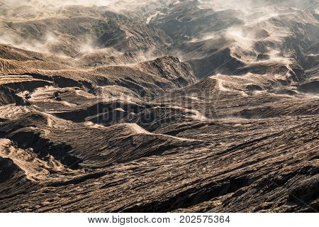 Cracks textures sand dune of Mount Bromo Volcano with golden light tone in Bromo Tengger Semeru National Park East Java Indonesia.