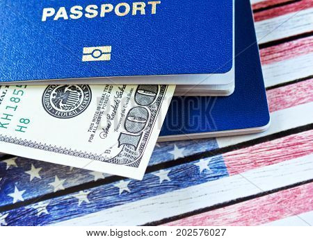 Immigration to the United States concept. Hundred dollars and two blue passports