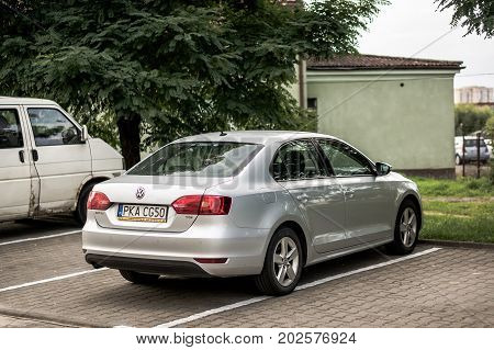 Parked gray Volkswagen Jetta car on a parking spot on August 2017 in Poznan Poland