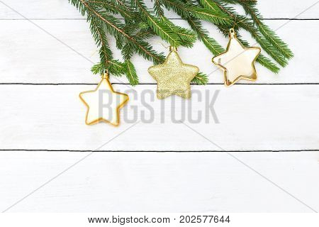 Christmas background. Christmas tree toys on a branch hanging
