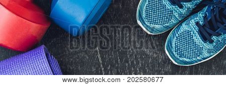Banner Yoga Mat, Sport Shoes, Dumbbells And Bottle Of Water On Blue Background. Concept Healthy Life