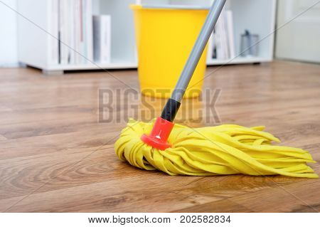 Cleaning mop tools on a parquet floor