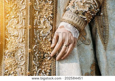 Clothes Of A Historical Imperial Woman With Pastel Tones, A Hand With A Ring With A Precious Stone