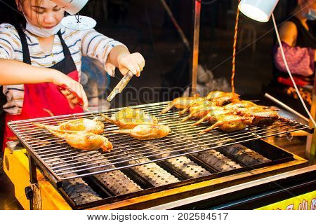 Nanning, China - June 9, 2017: Chinese Chef Preparing Barbecue On The Zhongshan Snack Street, A Food