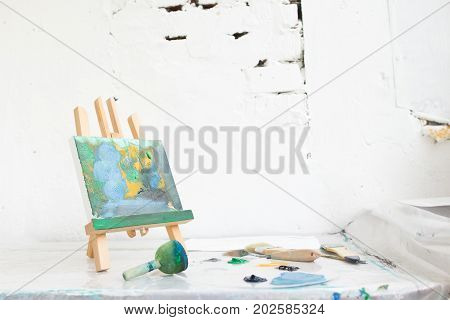 Art studio. Creative painter workplace with free space. Interesting hobby for children, abstract painting, craft tools, artistic concept