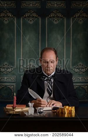 victorian miser recording his money in ledger