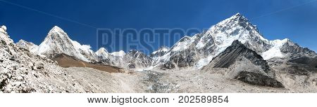 panoramic view of himalayan mountain range near Mount Everest with Khumbu Glacier Pumo Ri and Nuptse way to Everest base camp Khumbu valley sagarmatha national park Nepal