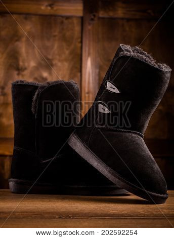 Close up view of pair of winter boots. Cozy and comfortable boots for walking in winter time.