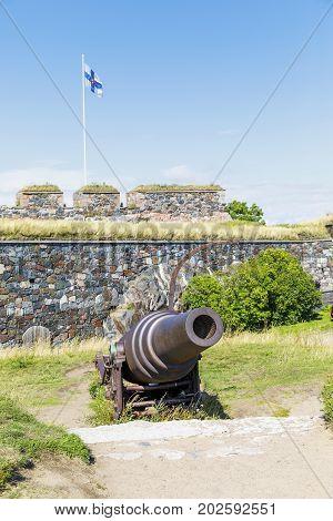 Old cannon in Suomenlinna fortress area in Helsinki Finland