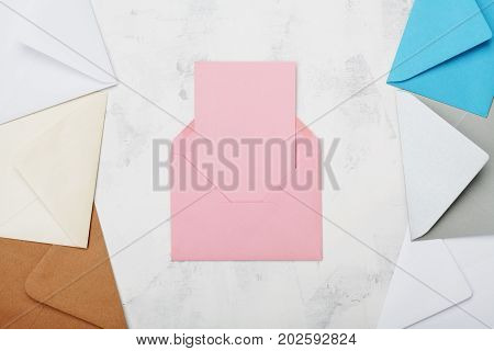 Opened mail envelope with empty card mockup or template top view. Business or private correspondence background. Flat lay.
