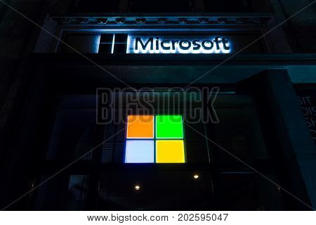 BERLIN GERMANY - OCTOBER 13 2015: Microsoft sign on a building in Berlin. Microsoft is a multinational technology corporation that develops supports and sells computer software and services.