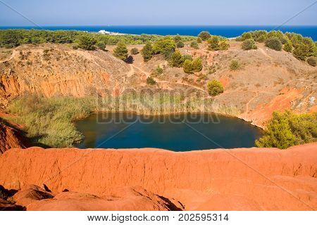 Little lake near a quarry of bauxite Apulia in Italy