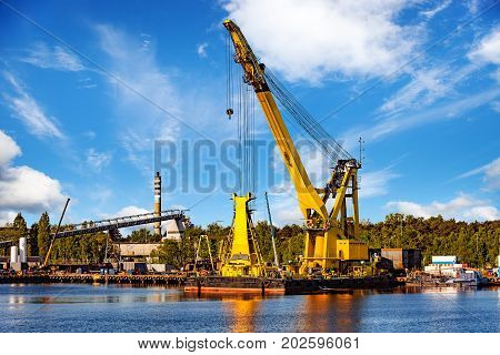 Huge floating crane at work in port of Gdansk Poland.