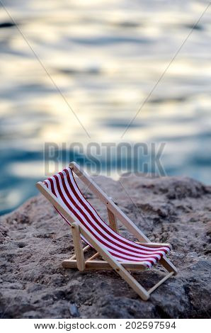 little small beachchair on stone close up