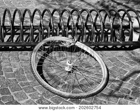 bicycle wheel on a rack left from a stolen bike