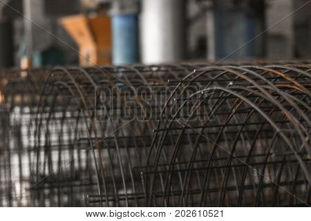 Metal frame in workshop of concrete batching plant, closeup