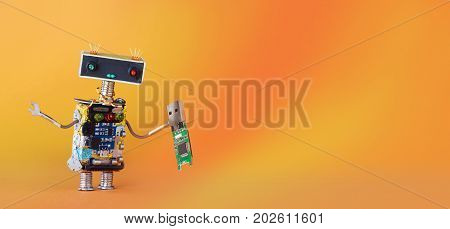 Data recovery backup service robot with usb flash storage stick. orange yellow gradient background, copy space.