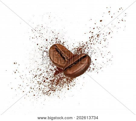 Two coffee beans collide in the air on white background